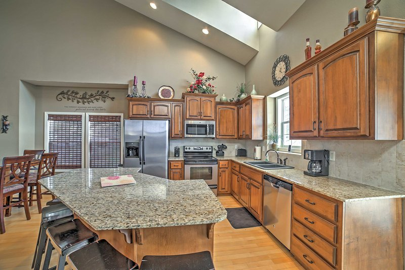 Whip up tasty meals in the fully equipped kitchen at this vacation rental home!