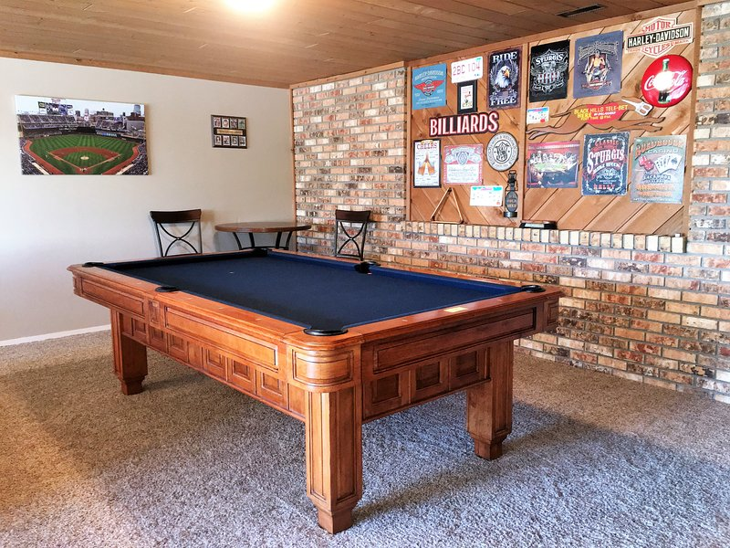 Enjoy playing billiards in the game area!