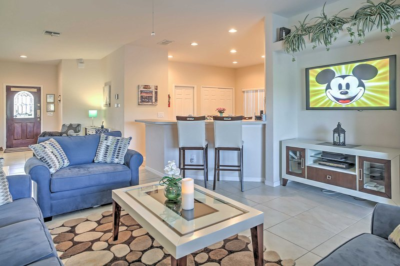 Gather with your guests in the open living room, equipped with a flat screen cable TV.