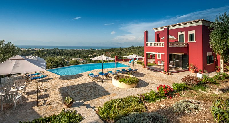 Special offer!Stylish vila Regina Rossa with unique sea views among olive trees!, vacation rental in Corfu