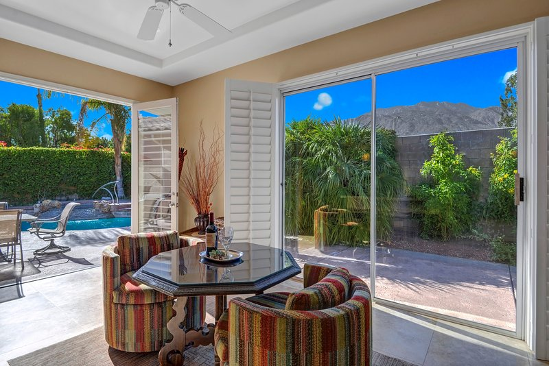 View San Jacinto Mountain and your Cascading Spa while Dining Inside or Out.
