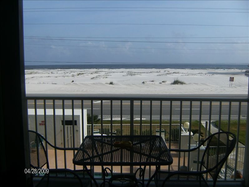 Balcony overlooks the outdoor pool and has a fantastic view of the ocean