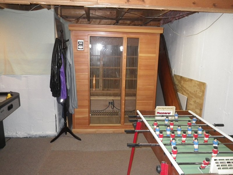 sauna and foos ball table in the game room