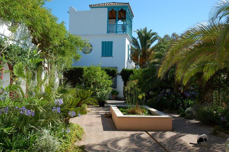 Casa Mosaica Torre Casita del jardín perfumado.