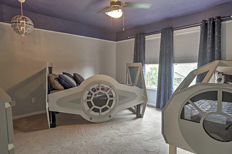 This bedroom has  a Star Wars theme.