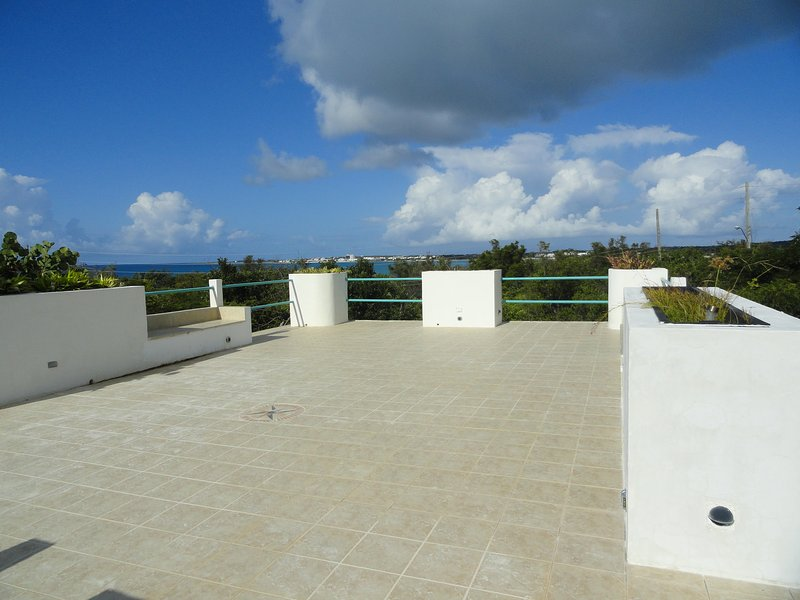 Roof Top Deck, Panoramic view of Rondezvous Bay, ST Martin & Stars.  We were    married up here.