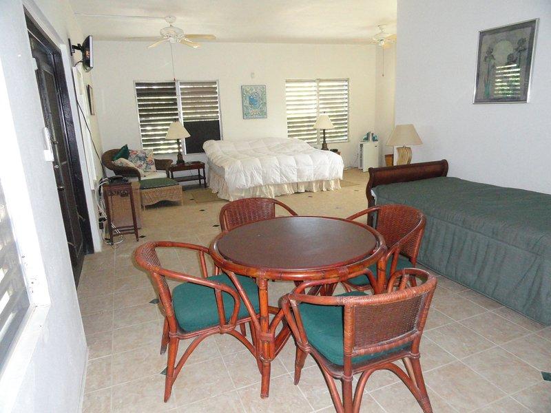 Bedroom 3, L shaped, king bed + 2 singles.  Good size room.