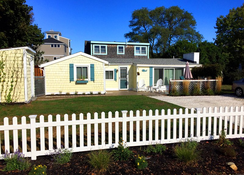 Charming and inviting coastal cottage with large wrap-around deck and great yard