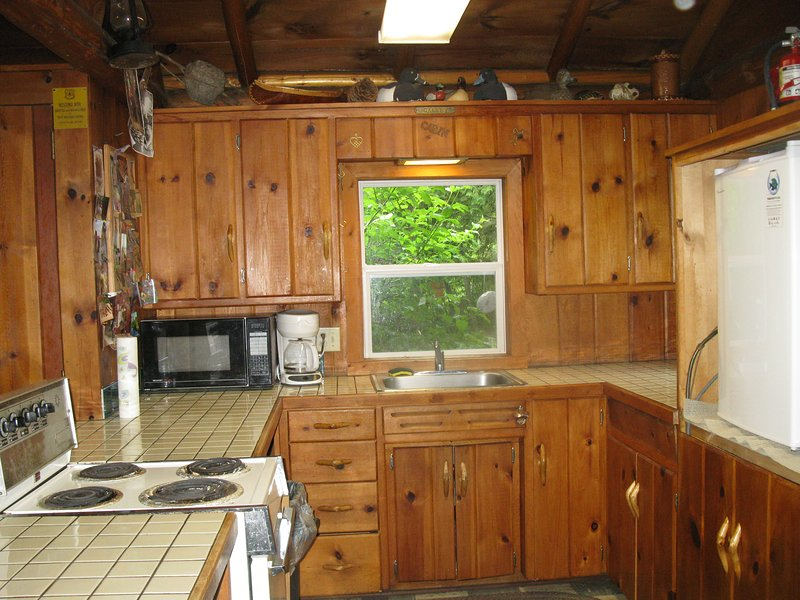 Complete kitchen with two refrigerators and freezer space.  Cooking utensils provided.