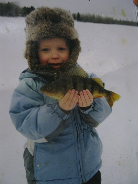 Kids and jumbo perch go together.  Guided ice fishing services, using tracked Pol Rangers available.