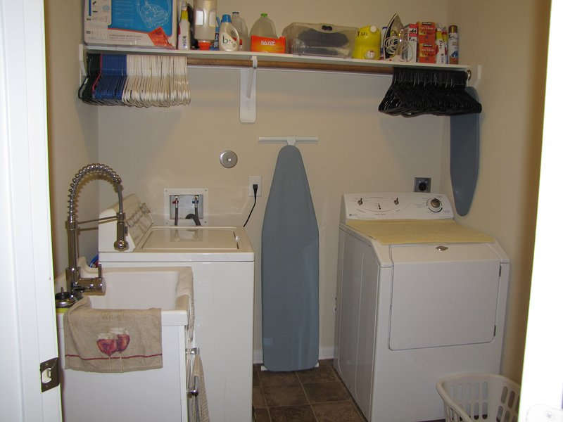 Complimentary clothes washer and dryer, irons and boards, utility sink; Upstairs Hallway