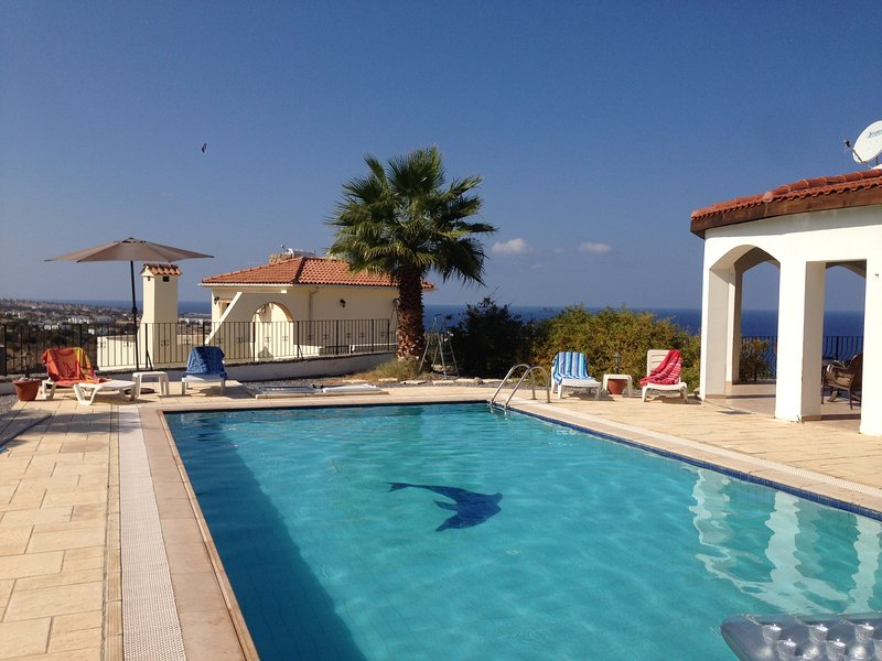Mature palm trees and spectacular views. Whilst still only a short walk to the beach.
