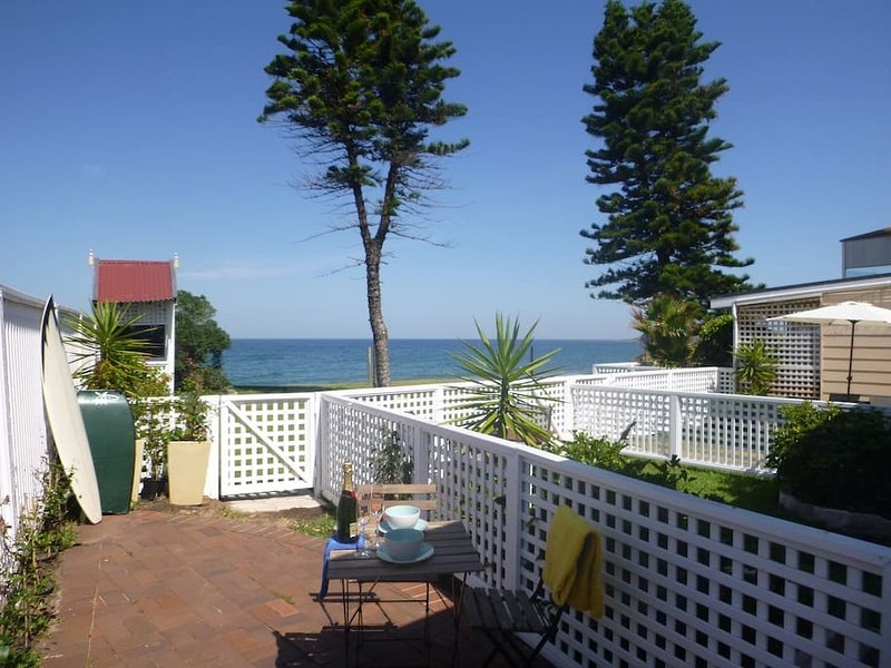 Sundrenched beachfront apartment with your own private yard leading onto Narrabeen's golden sands