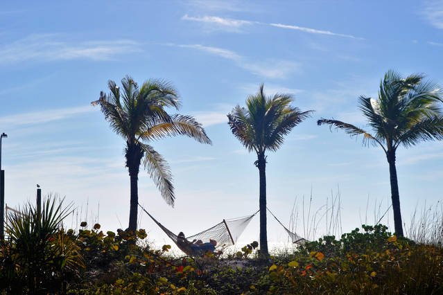 Rest & relax in beach hammocks while watching the Sunset!
