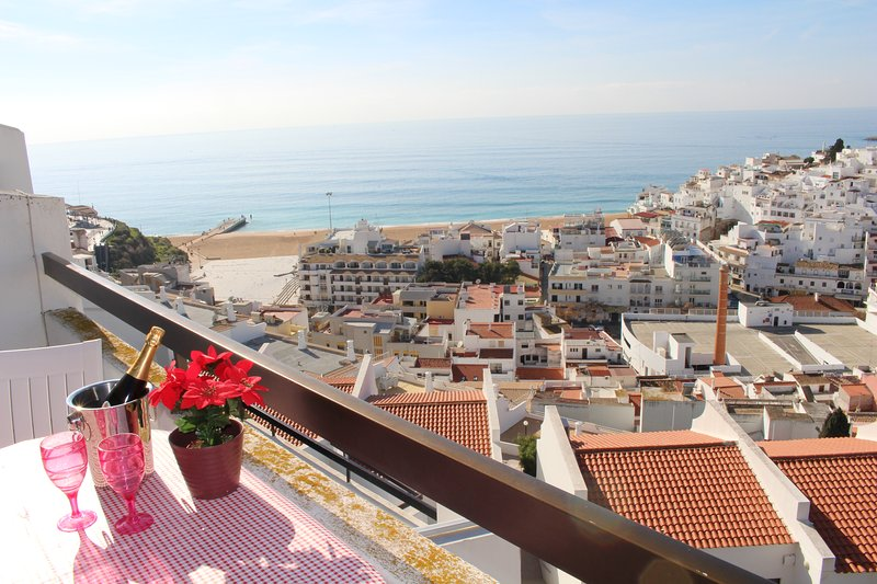 Dine on the terrace with panoramic views to the beach, sea and old town of Albufeira