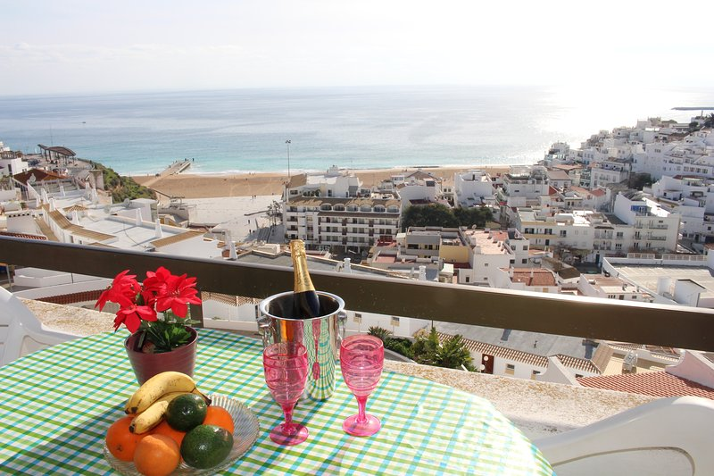 Dine on the terrace with panoramic views of old town Albufeira, the beach and ocean beyond
