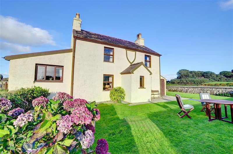 This traditional farmhouse has farmyard and outbuildings to the rear, but faces its own enclosed lawned gardens and lovely views