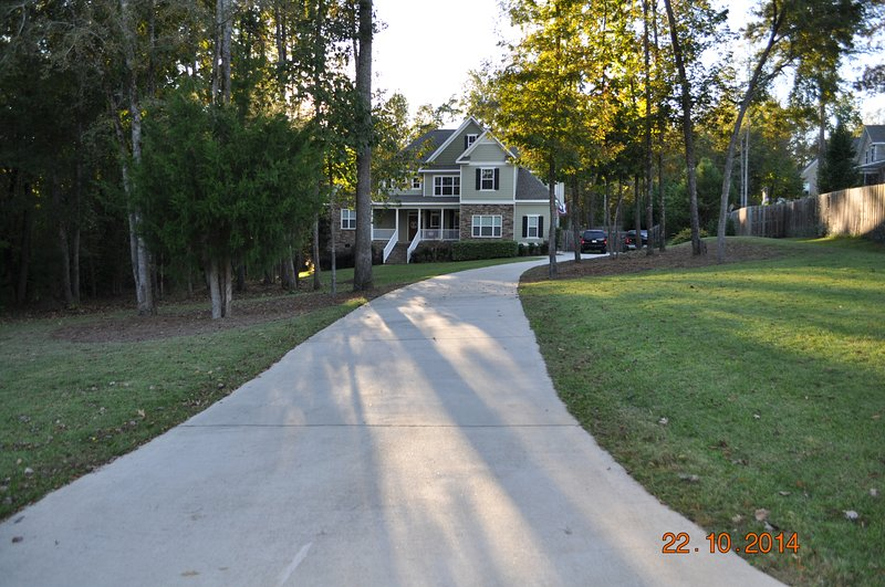 View of home from the street. Home sits away from the road for privacy. Lots of parking space.