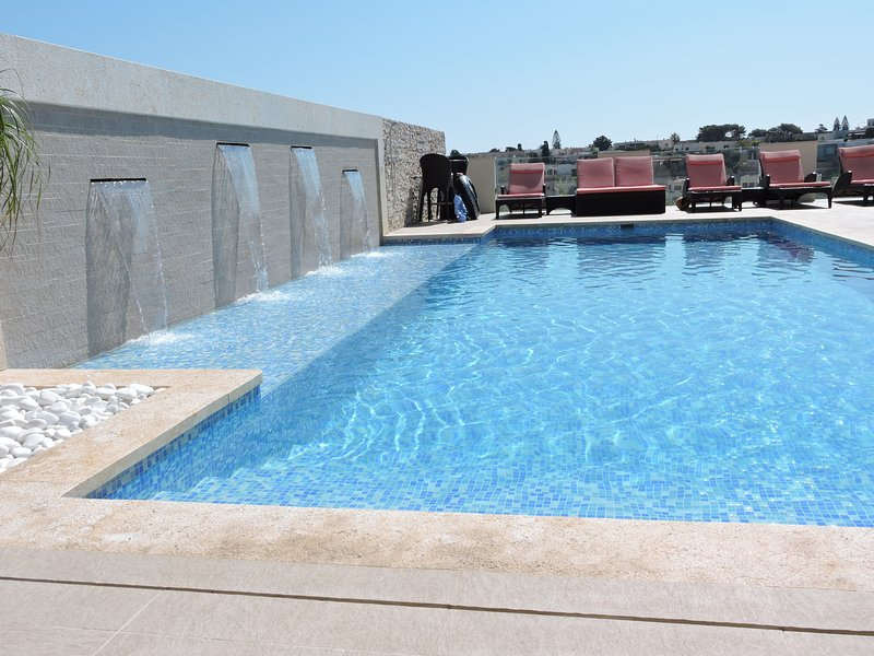 Large fantastic pool with sunbathing platform and bubble jets