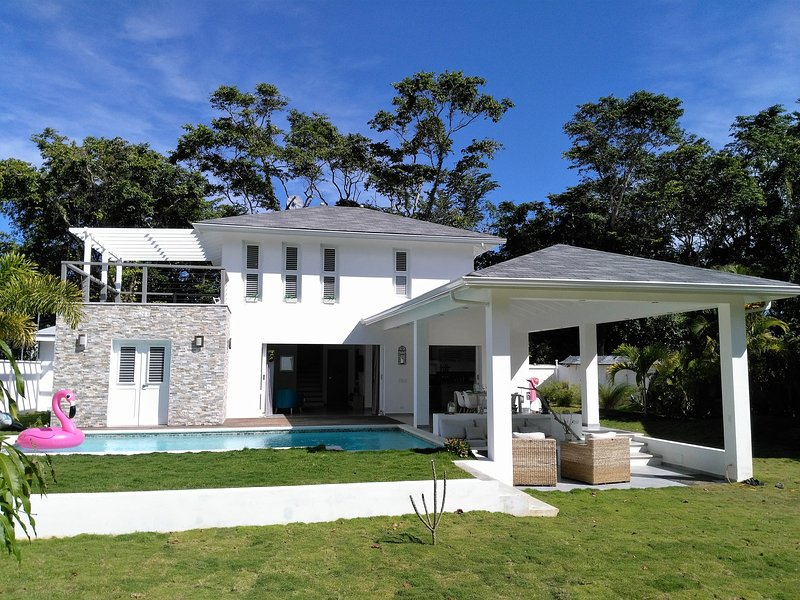 Front view  with pool and tropical garden