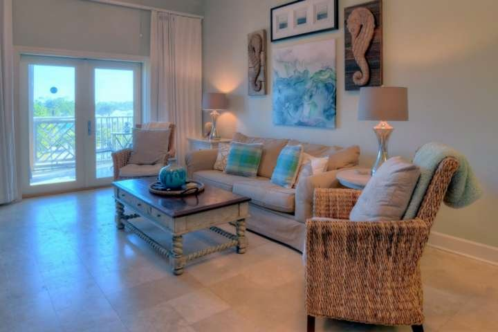 Spacious Living Area with Balcony Access overlooking the Lake and Resort Pool of Seagrove Highlands!