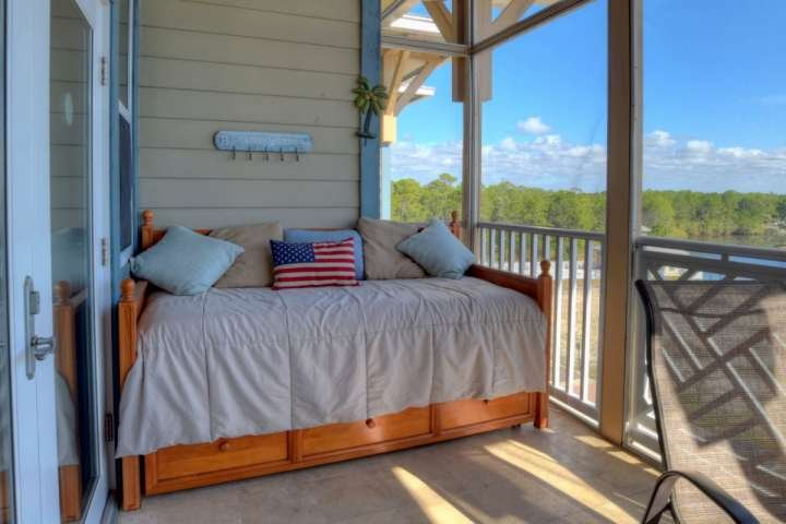 Daybed just off of the Screened Balcony of Shaw Shack! Enjoy the Lake Views and fresh air coming in from the Beautiful Gulf of Mexico!