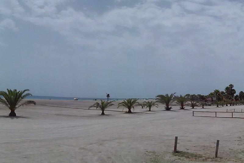 Praia ao lado da casa