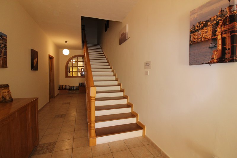 Common entrance hallway and stairs to first floor