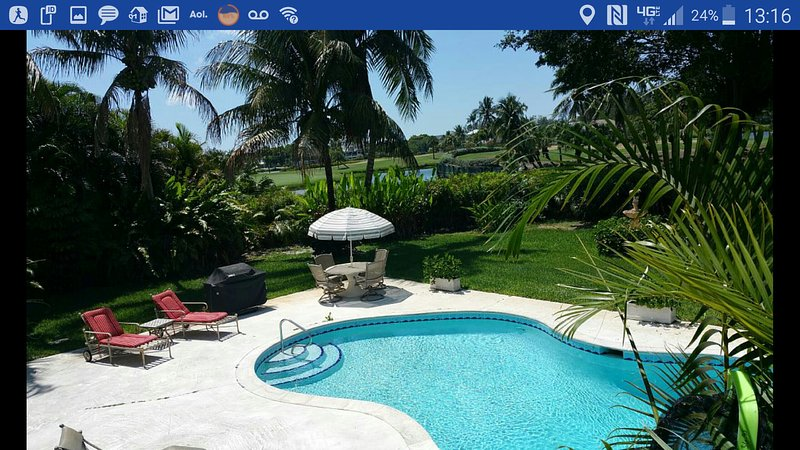 Magnificent view overlooking lakes and golf course, private heated pool, sun deck and  gardens.