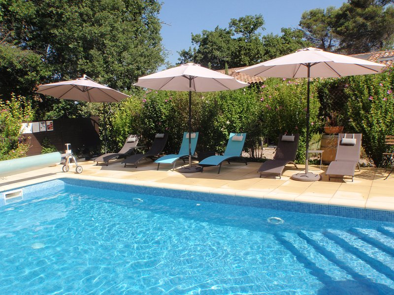 Pool with sun-loungers and parasols for shade