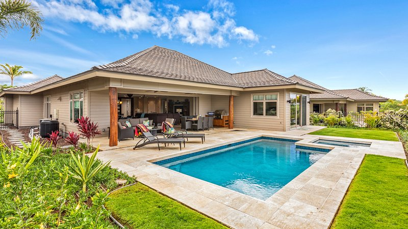Wide angle view of pool, spa, garden, lanai, and exterior of the estate home.