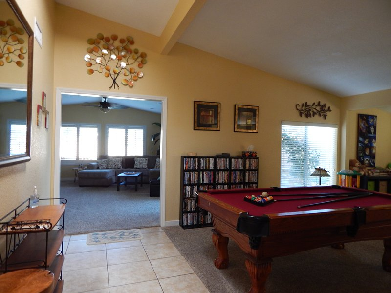 Colorful Game Room w/skylight, Pool Table, Family DVD's, & view into Family Room
