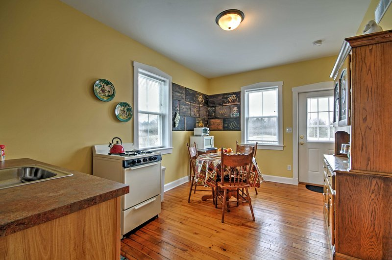 Handsome hardwood floors flow throughout the living space.