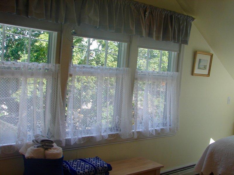 4 janelas olhar sobre vistas sazonais de Rockport Harbor e Bearskin Neck