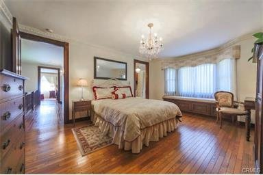 Beautiful Victorian bedroom, hardwood floor, in room full bathroom.