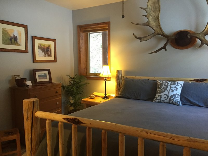 Moose room with comfortable king log bed.