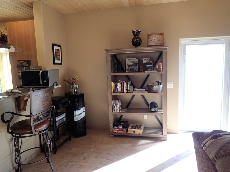 wine cooler, complementary bottle included and bookshelf with local info