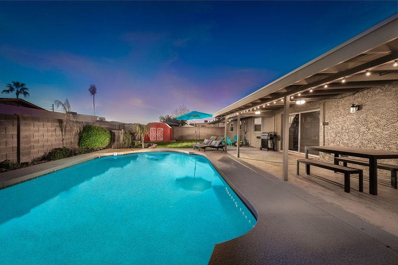 Private heated pool with string lights and outdoor fire-pit and games!