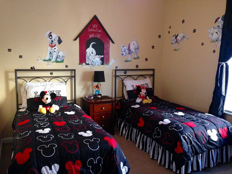 Kids' bedroom with twin beds and their own TV.