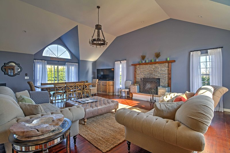 High-end decor, lots of natural light, and cathedral ceilings create a warm and inviting interior.