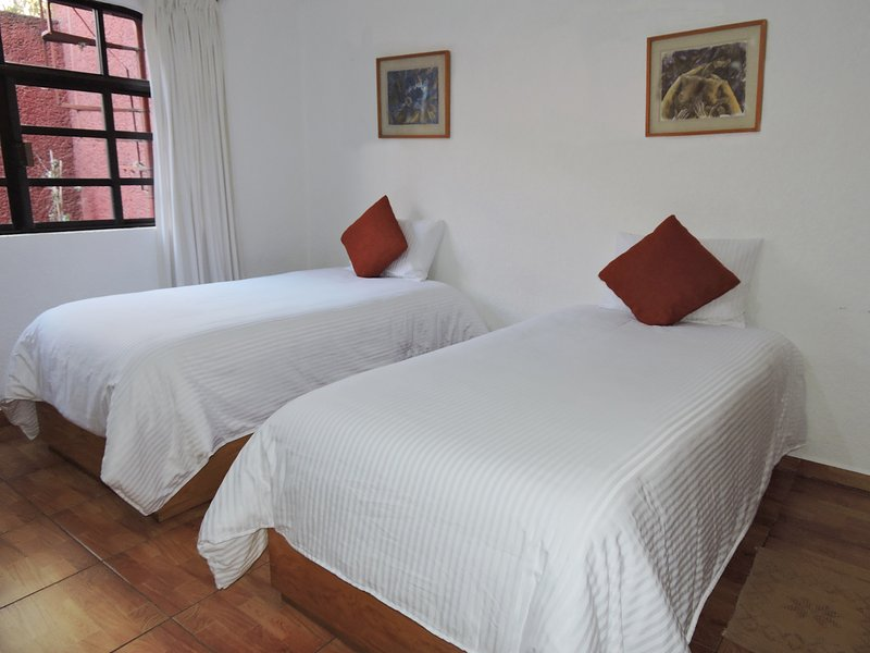 Comfortable room with two single beds. shared bathroom