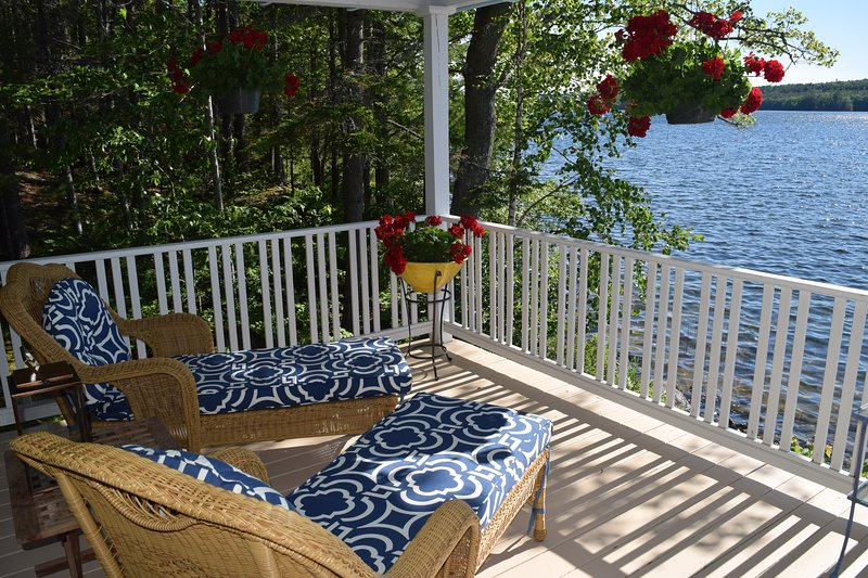 While away a summer afternoon on a lovely, flower-bedecked porch with views of the lake.