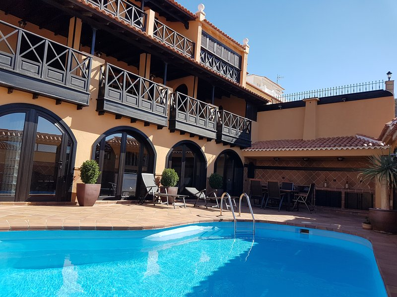 Large villa with wooden canarian balconies and private pool, private garden and terrace
