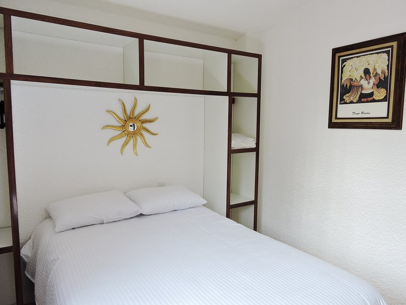 double bed, shared bathroom