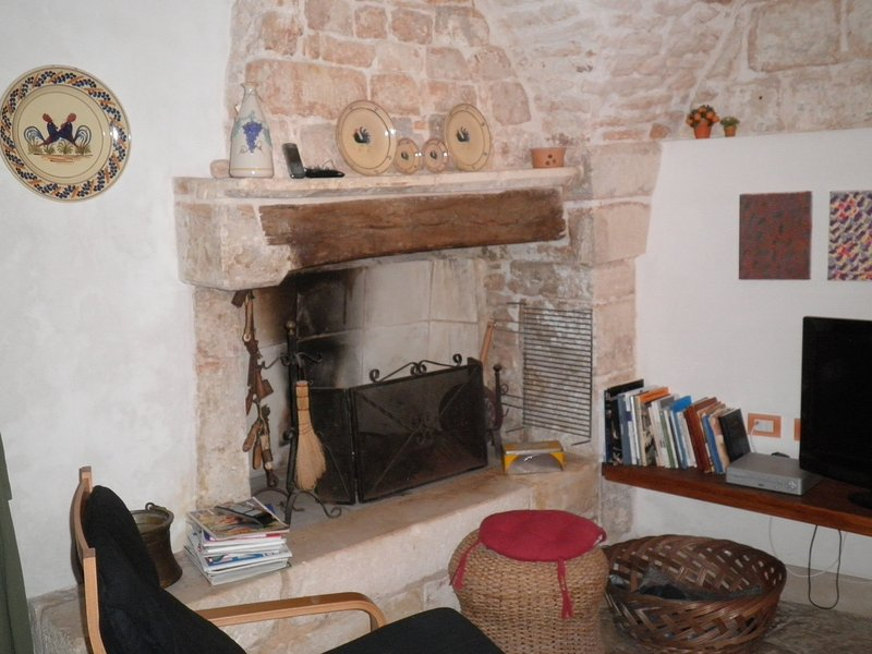 the old stone fireplace and oak beams