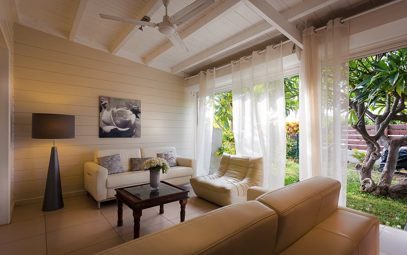cozy leather lounge on the veranda opening onto the frangipani