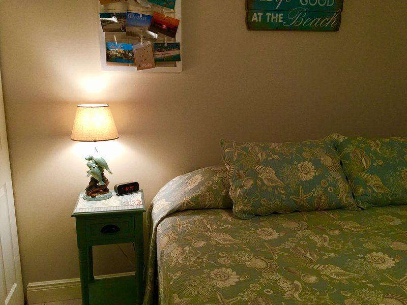 Handy bedside table with manatee lamp.