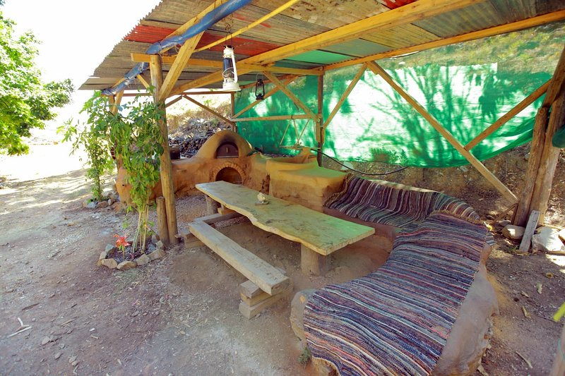 Wood-burning oven and outdoor sitting area