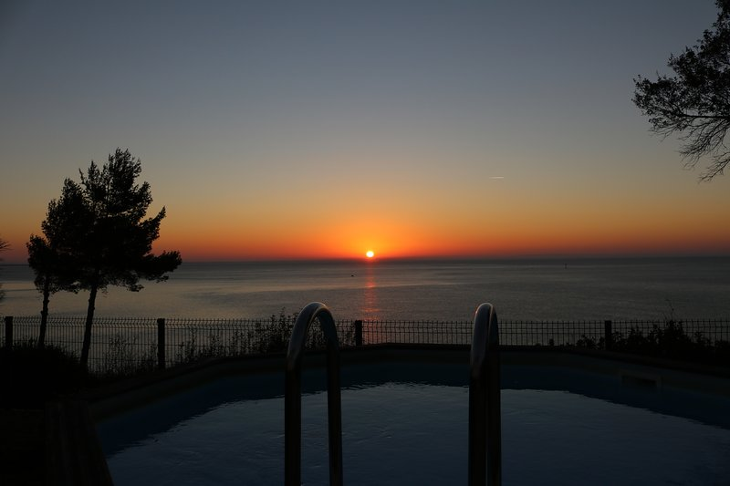 Winter sun rise over the pool