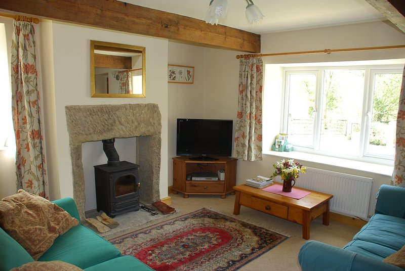 Cosy lounge with original beams, log burner, TV, DVD, 2 sofas (one converts to sofa bed)